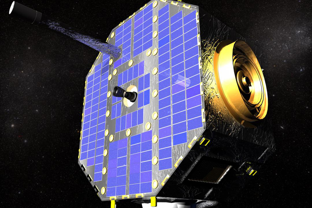 A gold satellite with blue solar panels in space