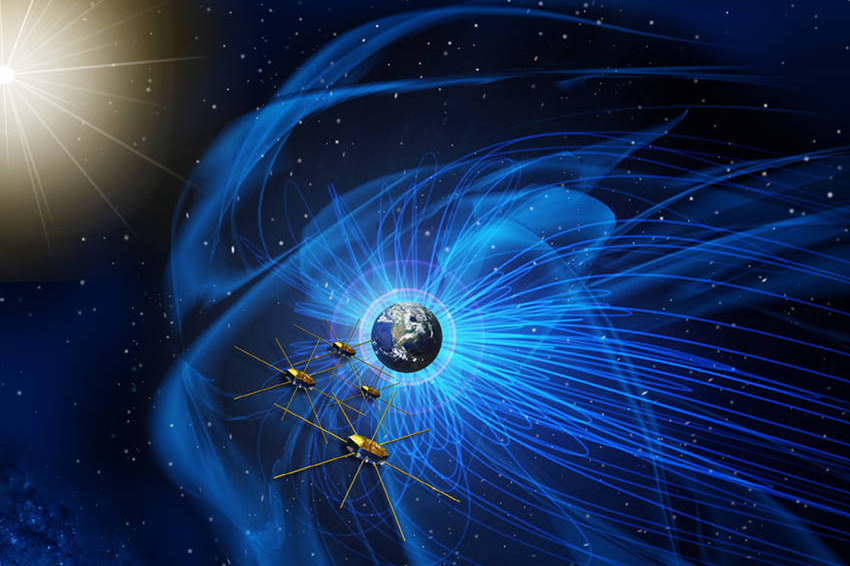 Earth with blue magnetic lines and four gold satellites with metal rods extending outward in space.