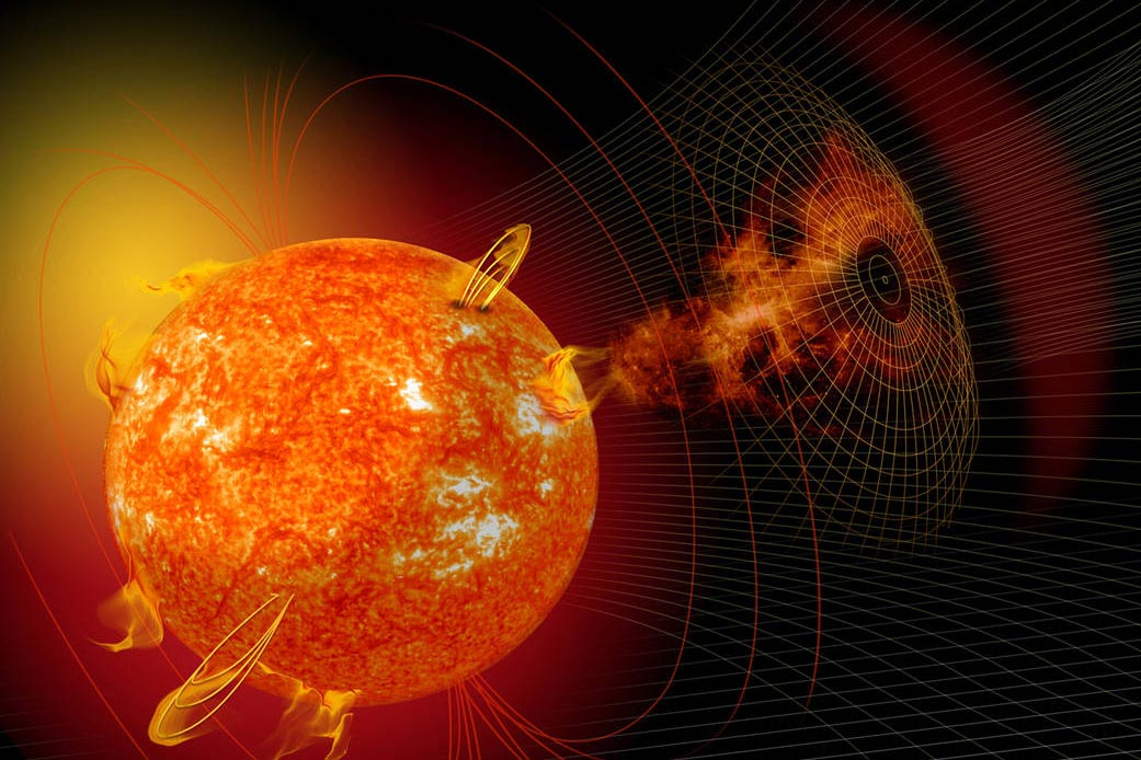An artist's rendering of the sun, with solar eruptions coming off the surface and a grid drawn nearby.