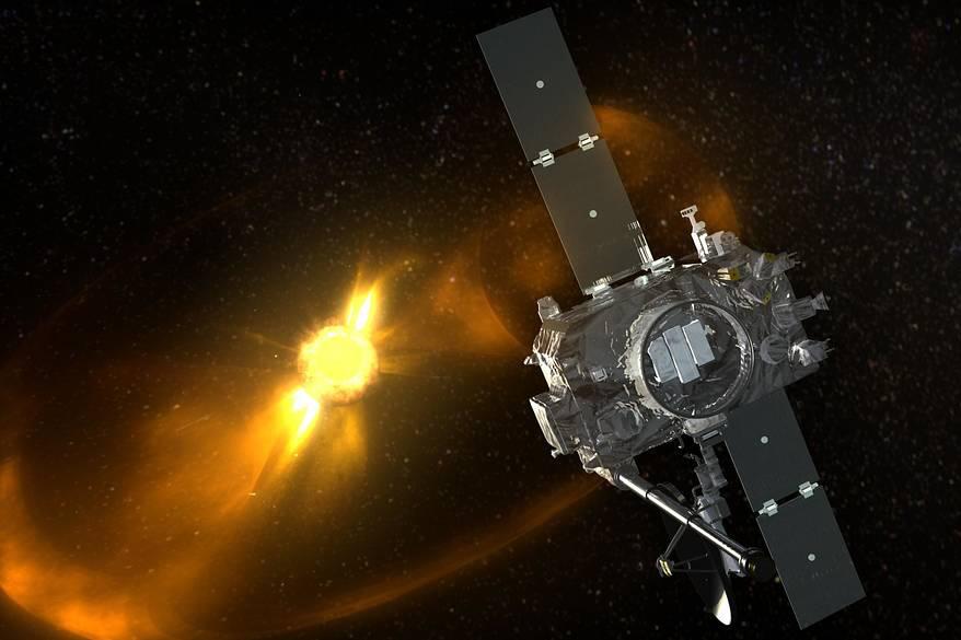 A silver satellite floating in dark space