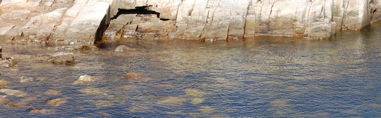 Rocky shoreline with rocks underwater