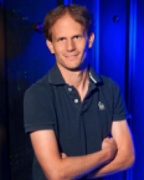 A headshot of Kai Germaschewski, a associate professor with the Space Science Center.