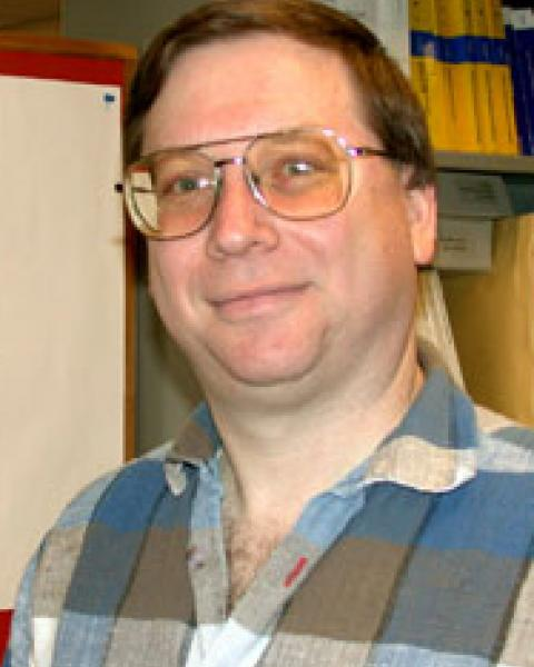 A headshot of Clifford Lopate, a research associate professor with the Space Science Center.