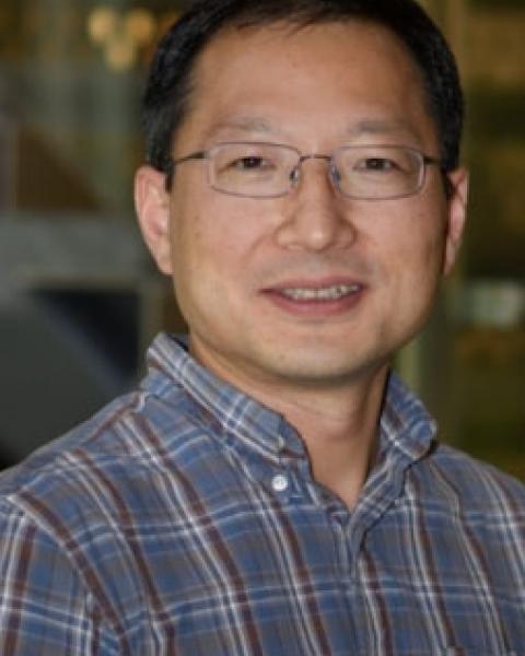 A headshot of Ningyu Liu, an associate professor in the Space Science Center.