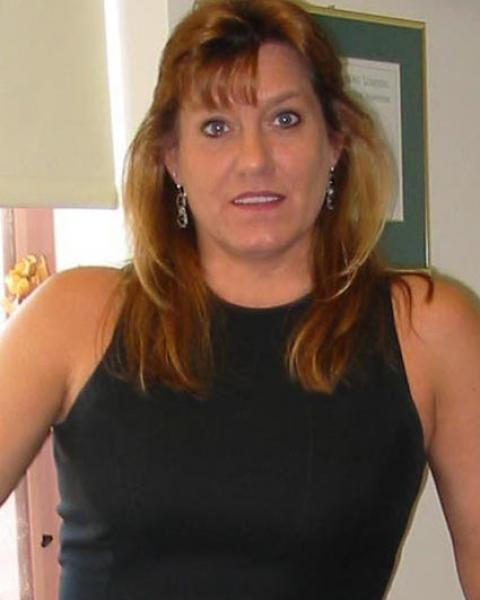 A headshot of Patricia Eckard, a business manager.