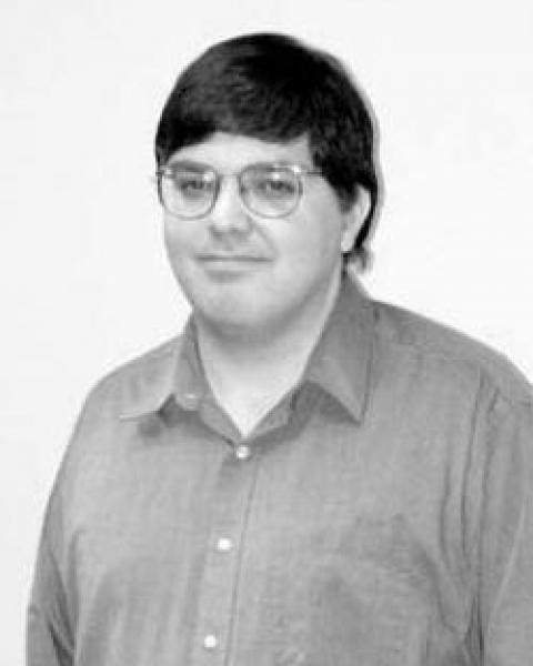 A headshot of Bernie Vasquez, a research professor in the Space Science Center.