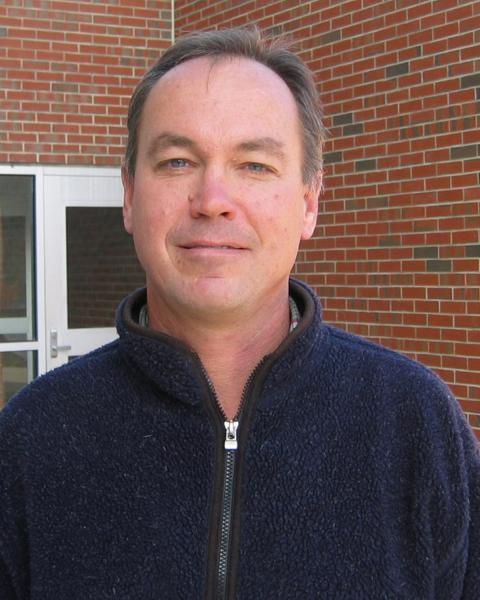 A headshot of David Shay