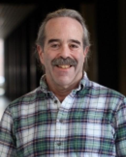 A headshot of Philip Isenberg