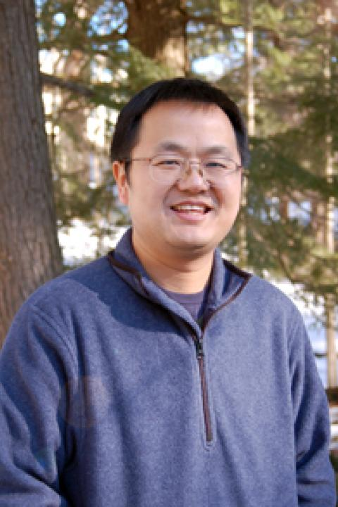 A headshot of Jingfeng Xiao, a research associate professor in the Earth Systems Research Center.