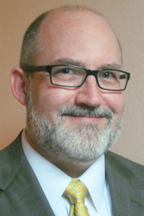 A headshot of Joseph Dwyer, a professor in the Space Science Center.
