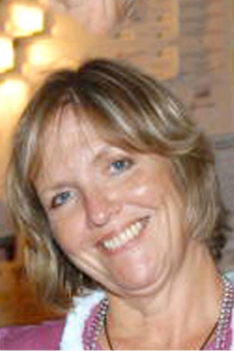 A headshot of Faith Sheridan, a senior administrative assistant.