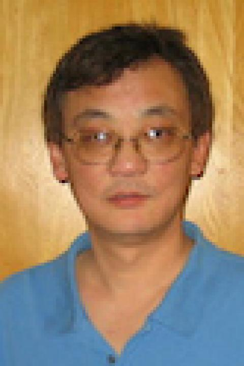 A headshot of Hui Feng, a research scientist with the Ocean Process Analysis Laboratory.