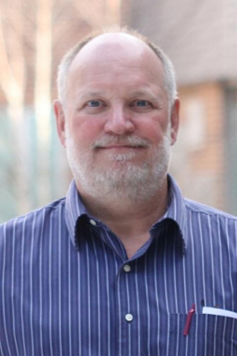A headshot of Joachim Raeder, a professor in the Space Science Center.