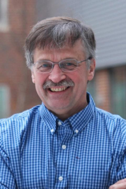 A headshot of Marc Lessard, an associate professor in the Space Science Center.