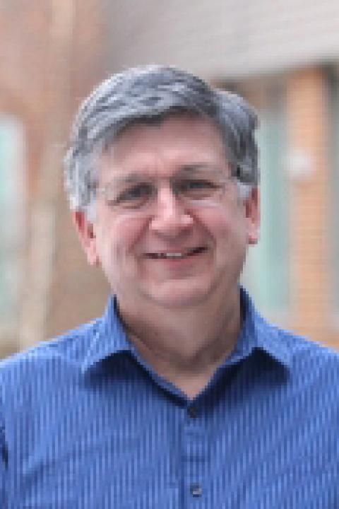 A headshot of Mark McConnell, a research professor for the Space Science Center.