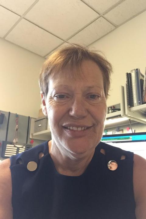 A headshot of Robbin McPherson, a senior administrative assistant.