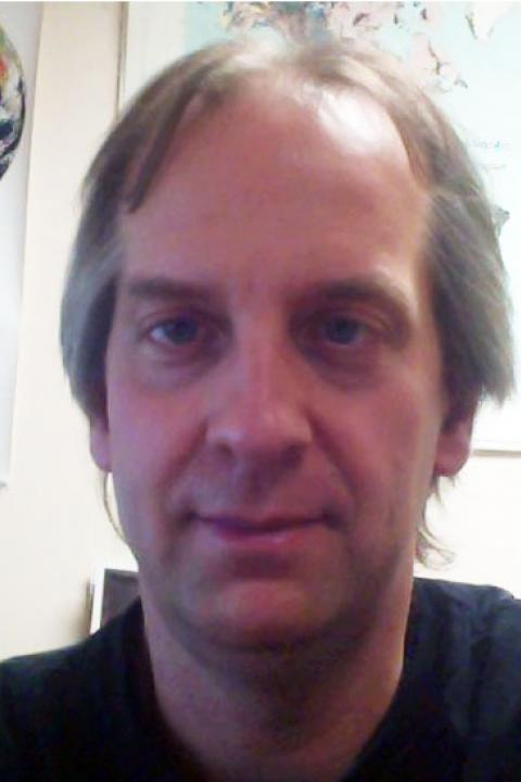 A headshot of Stanley J Glidden, an information technologist for the Earth Systems Research Center.