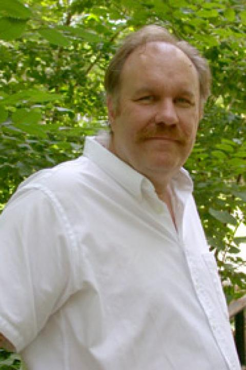 A headshot of Charles Smith, a research professor in the Space Science Center.
