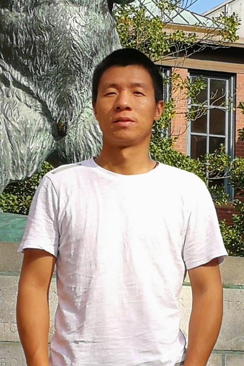 A headshot of Weizhi Lu, a visiting scholar with the Earth Systems Research Center.