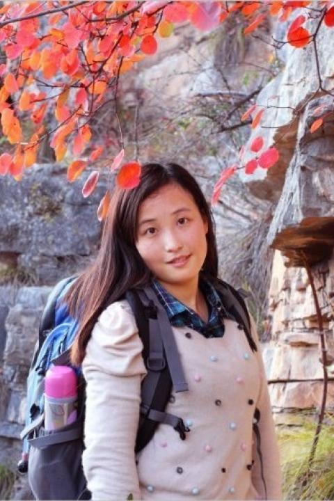 A headshot of Xiaojuan Huang, a visiting intern scholar.