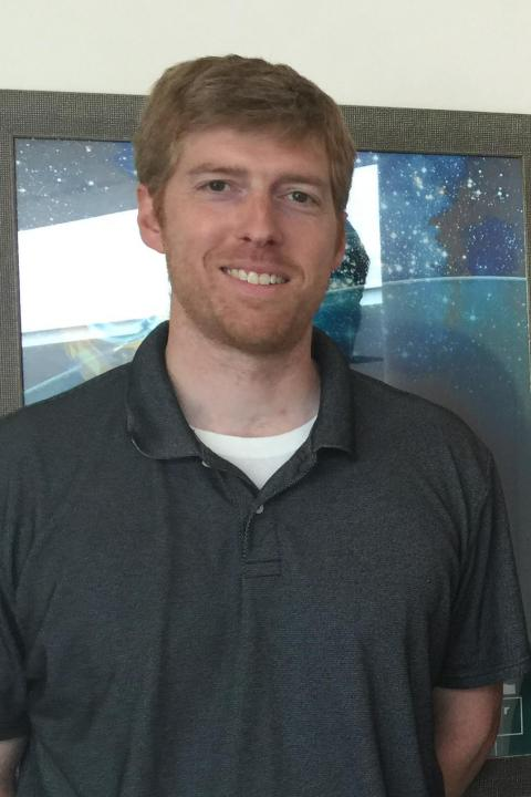 A headshot of Ivan Dors, a senior research project engineer in the Space Science Center.