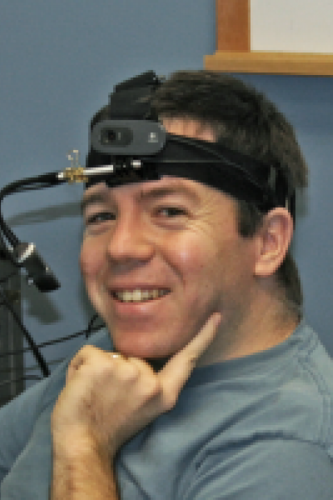 A headshot of Roland Arsenault, an information technologist with the Center for Coastal and Ocean Mapping.