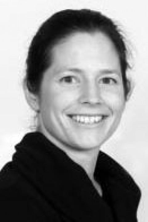A headshot of Ann Blomberg